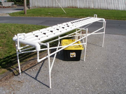 PVC system photo with support, channels and reservoir.